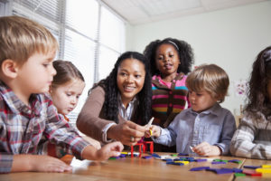 Daycare teacher and children; classroom ideas for July.